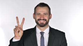 Retrato do homem de negócios Gesturing Victory Sign da barba vídeos de arquivo