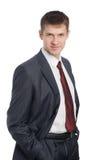 Retrato do homem de negócios novo de sorriso considerável Fotografia de Stock Royalty Free