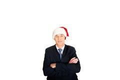 Retrato do homem de negócios seguro no chapéu de Santa imagem de stock