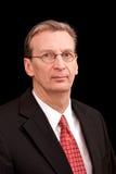 Retrato do homem de negócio mais idoso no preto Fotos de Stock Royalty Free