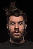 Retrato do homem desalinhado novo no estúdio Imagens de Stock