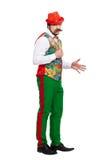 Retrato do homem engraçado que guarda o bigode falsificado sobre Fotos de Stock