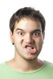 Retrato do homem fazendo caretas novo isolado no branco Fotos de Stock Royalty Free
