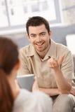 Retrato do homem feliz que conversa com mulher em casa Foto de Stock Royalty Free