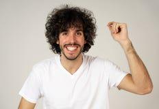 Retrato do homem novo alegre atrativo com a cara feliz de sorriso Express?es e emo??es humanas imagem de stock