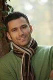 Retrato do homem novo considerável no parque do outono Fotos de Stock