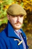 Retrato do homem novo na floresta do outono imagem de stock royalty free