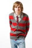 Retrato do homem novo na luz - cinza Fotografia de Stock Royalty Free