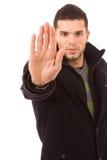 Retrato do homem novo que faz o sinal do batente Foto de Stock Royalty Free