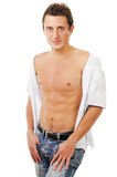 Retrato do homem novo 'sexy' na calças de ganga Foto de Stock Royalty Free