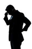 Retrato do homem que pensa a vista cansada para baixo Imagem de Stock Royalty Free