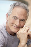 Retrato do homem que senta-se pela associação Imagem de Stock Royalty Free