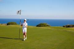 Retrato do jogador de golfe da jovem mulher Imagens de Stock