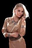 Louro novo encantador em um vestido Imagem de Stock Royalty Free