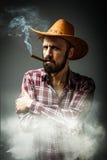 Retrato do menino da vaca com fumo ao redor Fotos de Stock