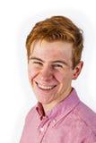 Retrato do menino de sorriso de riso atrativo no branco imagens de stock