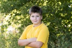 Retrato do menino dos anos de idade 10 no parque Fotografia de Stock