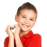 Retrato do menino feliz com uma forma do coração Fotografia de Stock