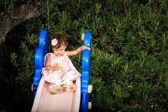 Retrato do miúdo em um jardim Imagem de Stock Royalty Free