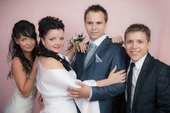 Retrato do noivo, da noiva e do melhor homem com a testemunha no estúdio foto de stock royalty free