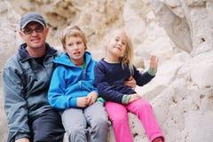Retrato do pai com duas crianças fotografia de stock