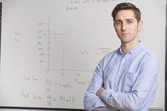 Retrato do professor Standing In Front Of Whitebaord Fotografia de Stock