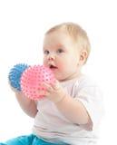 Retrato do rapaz pequeno com as duas esferas da massagem foto de stock