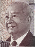 Retrato do rei Norodom Sihanouk de Camboja na cédula m de 1000 rieles Fotografia de Stock Royalty Free