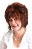 Retrato do sorriso triguenho bonito da mulher Imagem de Stock Royalty Free