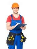 Trabalhador com ferramentas, planeamento e escrita a nota imagem de stock royalty free