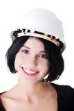 Retrato do trabalhador fêmea seguro no capacete. Fotografia de Stock Royalty Free