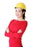 Retrato do trabalhador fêmea seguro no capacete. Imagens de Stock Royalty Free