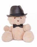 Retrato do urso de peluche com laço e chapéu de curva Fotos de Stock Royalty Free