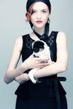 Retrato do vintage de uma senhora com um cachorrinho Imagens de Stock Royalty Free