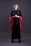 Jovens mulheres no vestido longo preto Imagens de Stock Royalty Free
