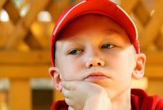 Retrato el muchacho en un casquillo Fotografía de archivo libre de regalías