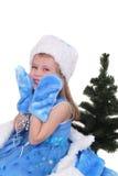 Retrato emocional de una muchacha alegre en vestido azul en el fondo blanco Año Nuevo Imagen de archivo libre de regalías
