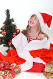 Retrato emocional de una muchacha alegre en vestido rojo Año Nuevo Fotografía de archivo libre de regalías