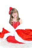 Retrato emocional de una muchacha alegre en vestido rojo en el fondo blanco Año Nuevo Imagen de archivo libre de regalías