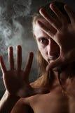 Retrato en un humo Foto de archivo libre de regalías