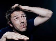 Retrato engraçado do homem scared fotografia de stock