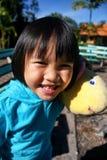 Retrato exterior de uma menina asiática bonita Imagens de Stock