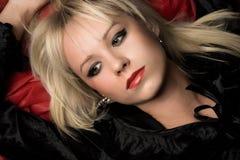 Retrato fêmea no vermelho Fotos de Stock Royalty Free