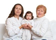 Retrato feliz de la familia - abuela, hija y nieta Imágenes de archivo libres de regalías
