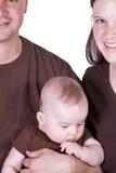 Retrato feliz de la familia con la madre, el padre y el hijo Foto de archivo libre de regalías