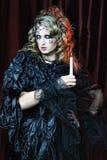 Retrato gótico da mulher com vela fotos de stock royalty free