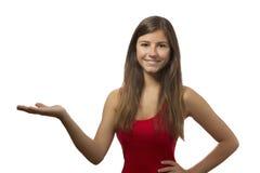 Retrato hermoso del adolescente que muestra con la mano abierta Imagenes de archivo