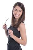 Retrato isolado de uma mulher de negócios em um vestido preto com vidro Fotos de Stock Royalty Free