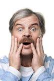 Retrato maduro espantado do homem isolado no branco Imagens de Stock