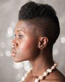 Retrato negro del perfil de la muchacha Imagenes de archivo